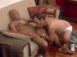 Couple making sweet gay love on the couch...