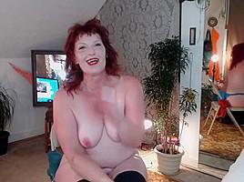 V90 redhead milf in a smoking reading erotica...