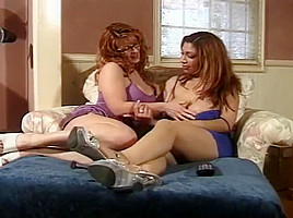 Big breasted lesbian sucks on her girlfriends erect...