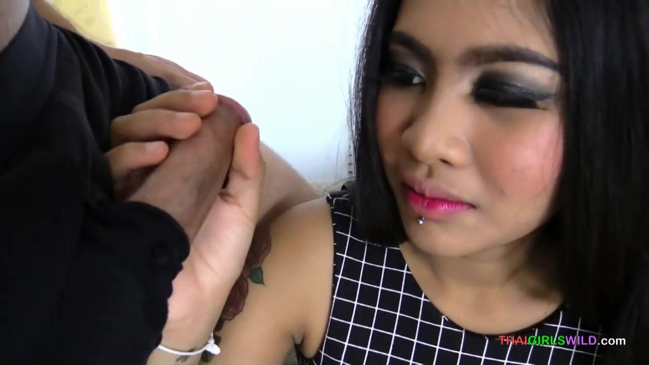 Cute tattooed Thai teen gives me a sensual blowjob