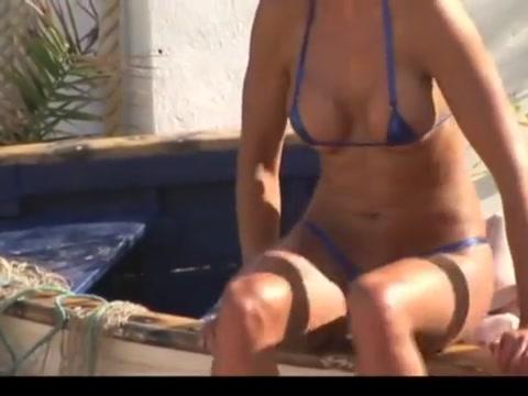 Posing in tiny string bikini on the beach