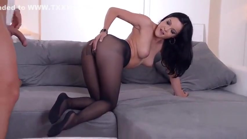 Seductive brunette Dolly Diore teasing guy with a footjob